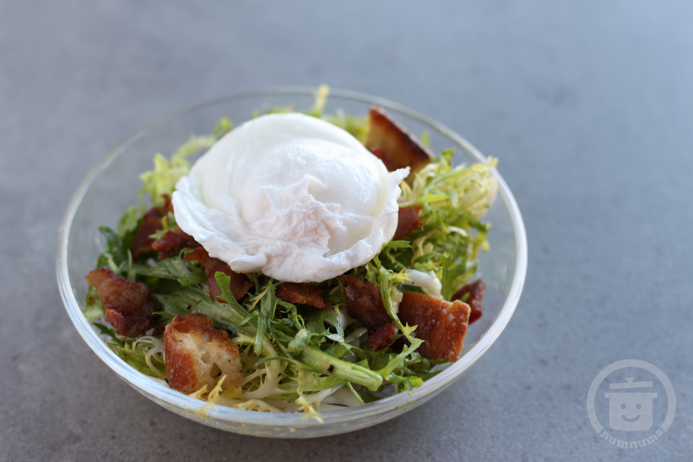 Lyonnaise frisee salad with bacon croutons