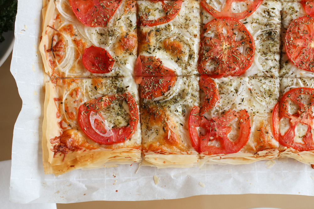 Parmesan phyllo pizza with onions and tomatoes