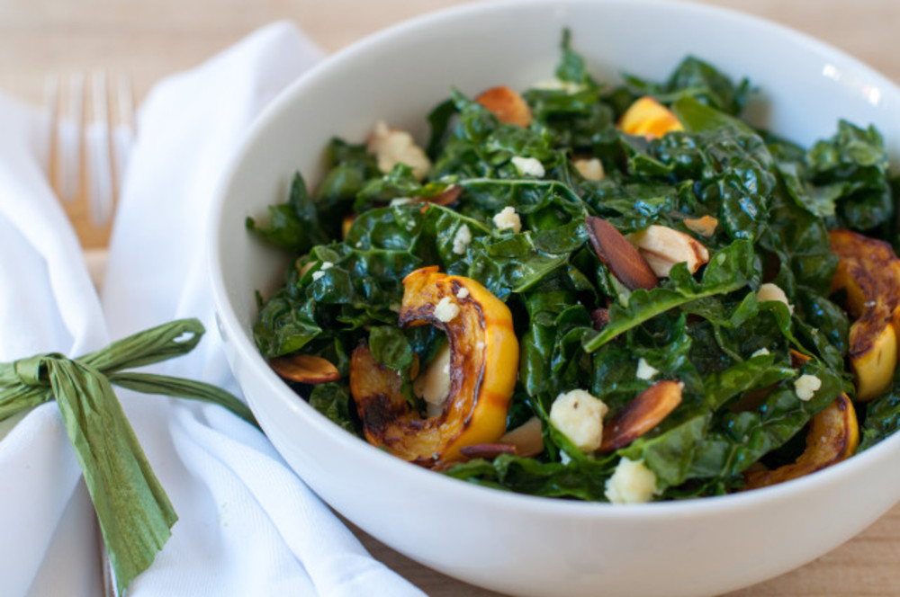 Kale salad with delicata squash, almonds and aged cheddar on numnums ...